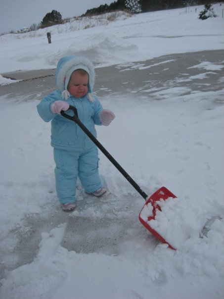 Adelyn shoveling snow